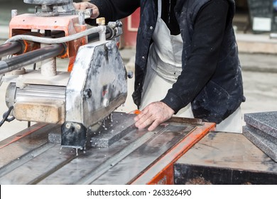Workers are working, cutting marble cutter