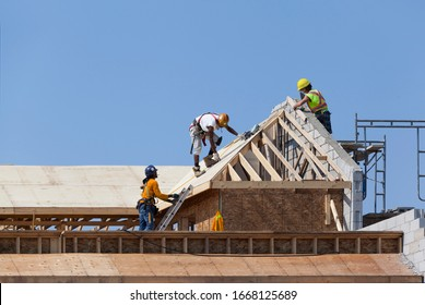 Workers are working on the roof at construction