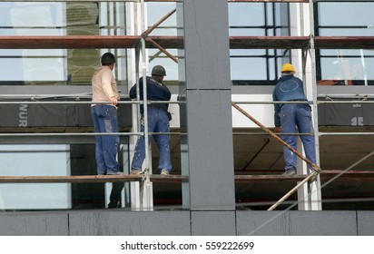 Workers working on scaffolding on the building