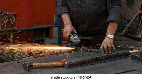 Workers\u0026#39; hands in the metal industry with power cutters