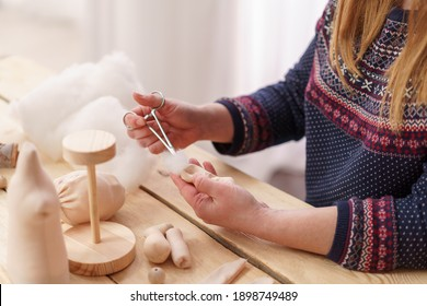 Workflow, masters of making handmade dolls, made by hand from textiles, in a retro style. a designer doll with a human face. Shaping the doll's body. companion doll. creating dolls, an exclusive gift