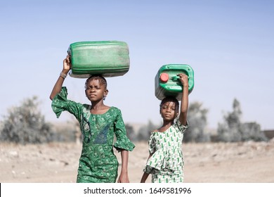 Working African Girl with Natural Water for a dehydration concept