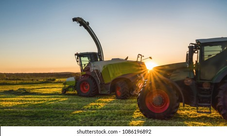 Working agicultural machinery on a sunny spring day - sunset or sunrise