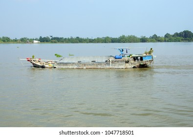 Working barges on the Mekong River,  Vietnam