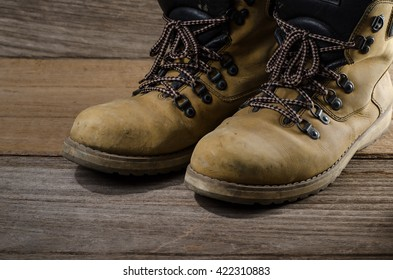 working boots on wood board construction concept.