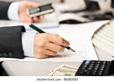 Working business man hand pen writing paper document at office workplace desk