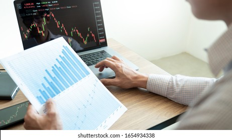 Working business man, team of broker or traders talking about forex on multiple computer screens of stock market invest trading financial graph charts data analysis