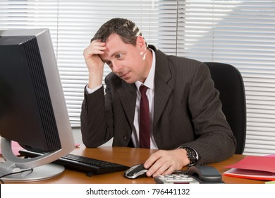 working businessman at computer desk in office