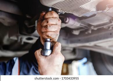 Working in a car repair service