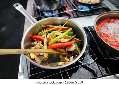 Working chef preparing food, Food frying in wok pan,Close up, chef cooking