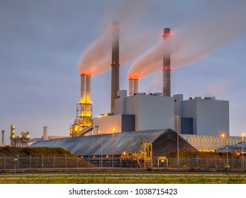 Working Coal powered electicity power plant in Europoort area with supply in foreground, Maasvlakte Rotterdam Netherlands