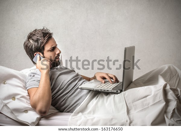 Working with Computer in Bed