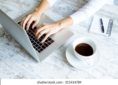 Working in the computer and drinking a coffee