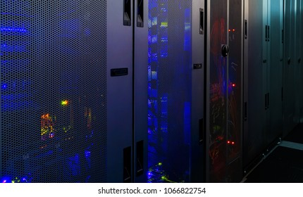 Working computer server for latticed doors. data center room with modern communication and server equipment.