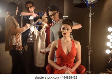 Working crew process in studio dressing room