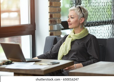 Working day, attractive business woman. Portrait business woman sitting at her workplace in the office.