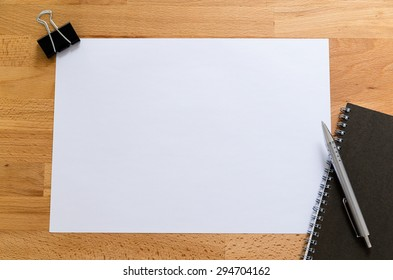 Working desk with plain paper for adding some information