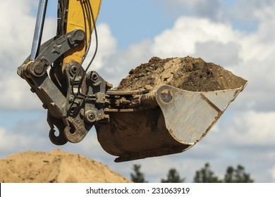 Working with excavator at road construction site