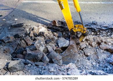 Working Excavator Tractor Digging street city