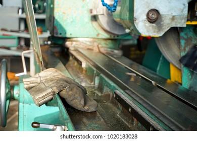 Working gloves on the machine. Work glove.