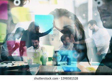 Working group of businessmen exults for having achieved the goal. concept of teamwork and business partnership. double exposure