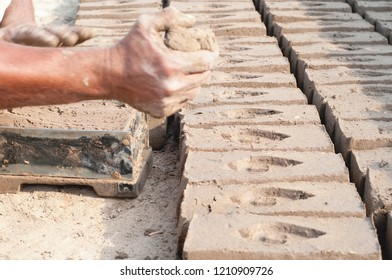 The working hands with mud and clay