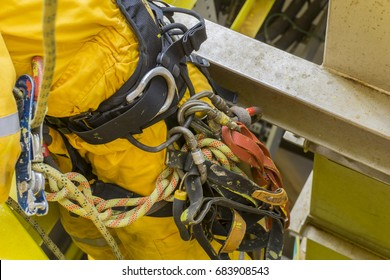 Working at height. Close up of abseiling equipment attached to worker's body.