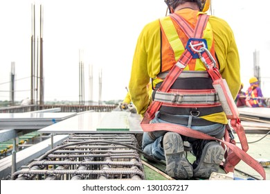 Working at height equipment. Fall arrestor device for worker with hooks for safety body harness