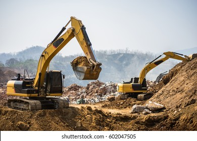 Working hydraulic excavators in the mine. Working in mining industry. Mining activities. Mine operations. Quarry Operations.