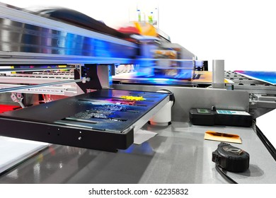 Working industrial large format UV inkjet printer for printing on big sheets of plastic or billboards isolated over white