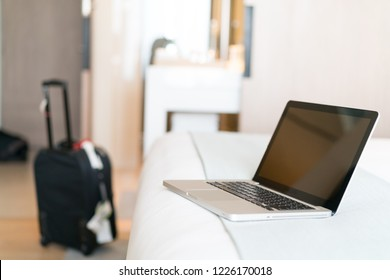Working with a laptop on the bed