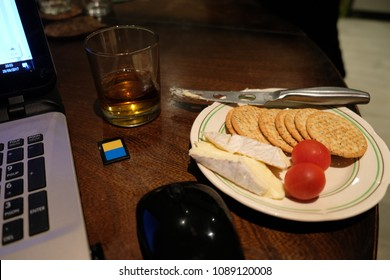 Working late with cheese and crackers and an Irish Whisky,