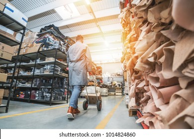 Working at leather warehouse at shoe factory used warehouse equipment. manager