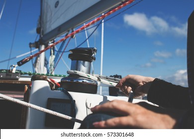 Working the line on a sail boat.