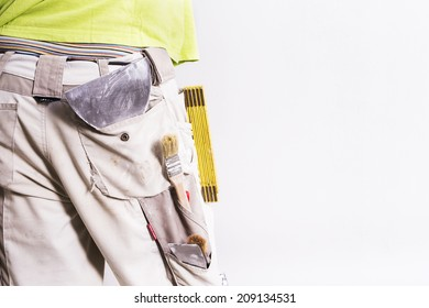 Working man buttock with tools in his pocket