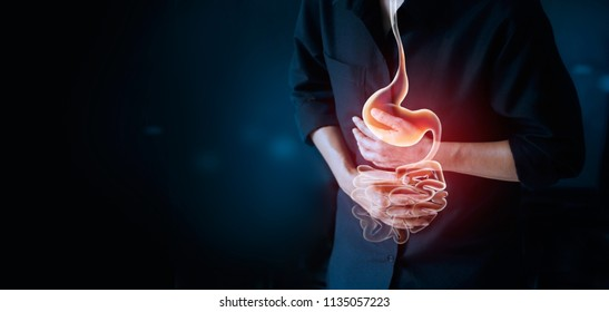 Working man touching stomach, suffering painful of stomachache, gastrointestinal system desease during working cause of stress from work, Health insurance care concept