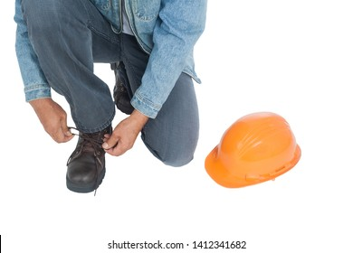 Working men are tying shoes He placed a helmet on a white background. clipping path