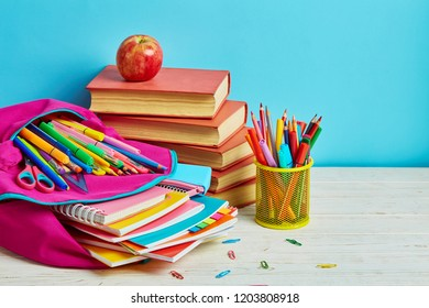 Working mess on the table in the student. School and office supplies frame