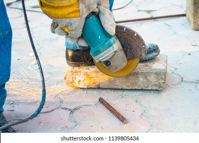 Working mode grinding machine iron rod, sparks fly in different directions.