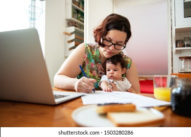 Working mom with baby in a lap