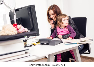 Working Mom And Daughter At The Office