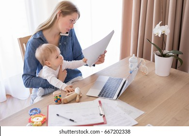 Working mom talking on the phone with child in her lap