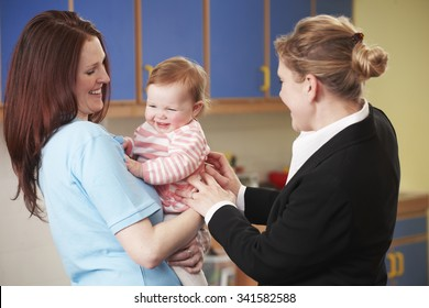 Working Mother Dropping Child Off At Nursery