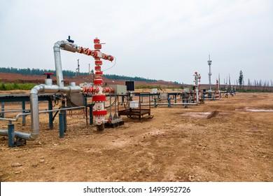 Working oil well, oil pipeline crane, Siberia, Russia, soft focus