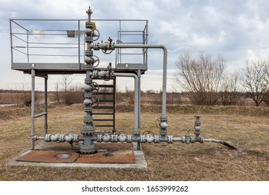 Working oil well, oil pipeline crane. production wellhead. Offshore the Industry oil and gas production petroleum pipeline. Dirty pipe structure of an oil well.