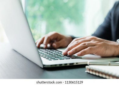 working on laptop, close up of hands of business man working and use smartphone for connection