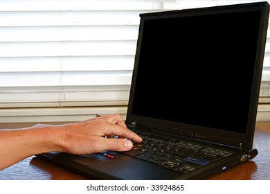 Working on a laptop computer sitting on a desk