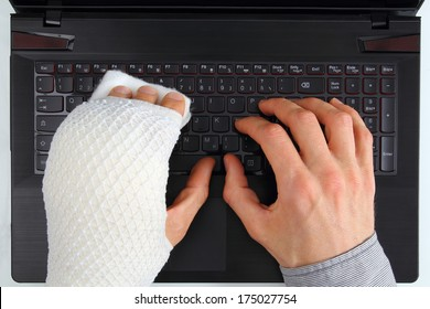 Working on a notebook with hand injury