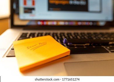 Working on a presentation for social media at home - freelance and school home work | Modern laptop and workstation - Abu Dhabi, UAE, June 22, 2020
