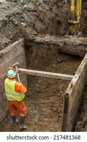 working on trench construction, underground installation by open trench method